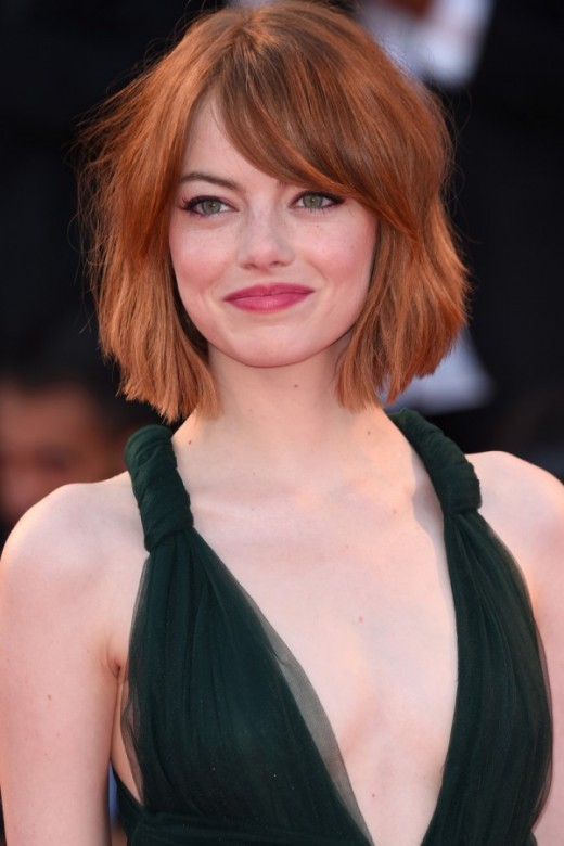 Photo of Emma Stone with a short bob and side swept bangs
