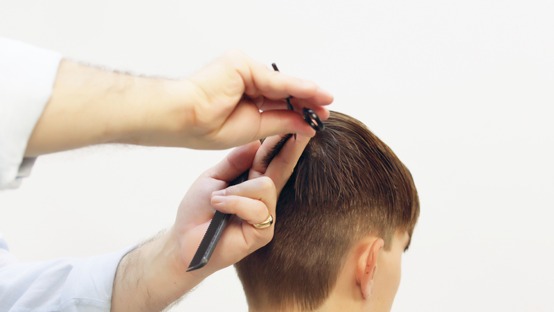 Photo of a haircut tutorial on a male model