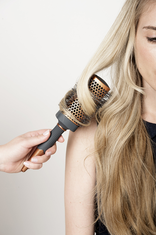 curl with a brush blowout tips