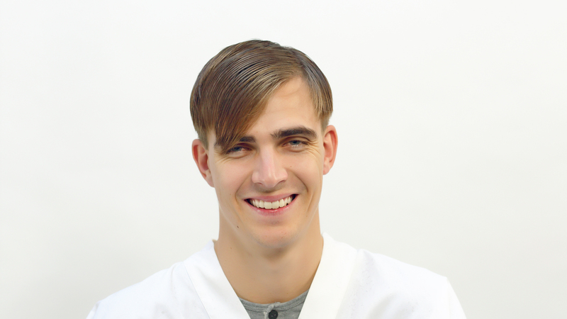 Photo of a man with a side part