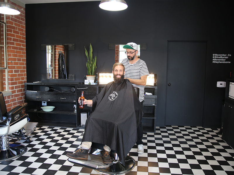 Photo of a man with a beard about to get a haircut