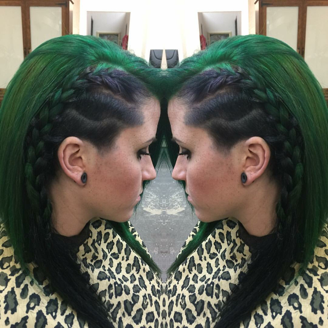 Shaved side with design green and black hair