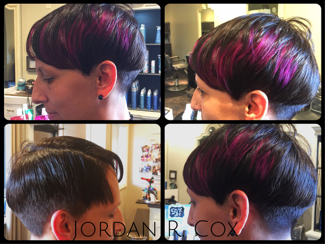 Layered pixie undercut with vibrant highlights.