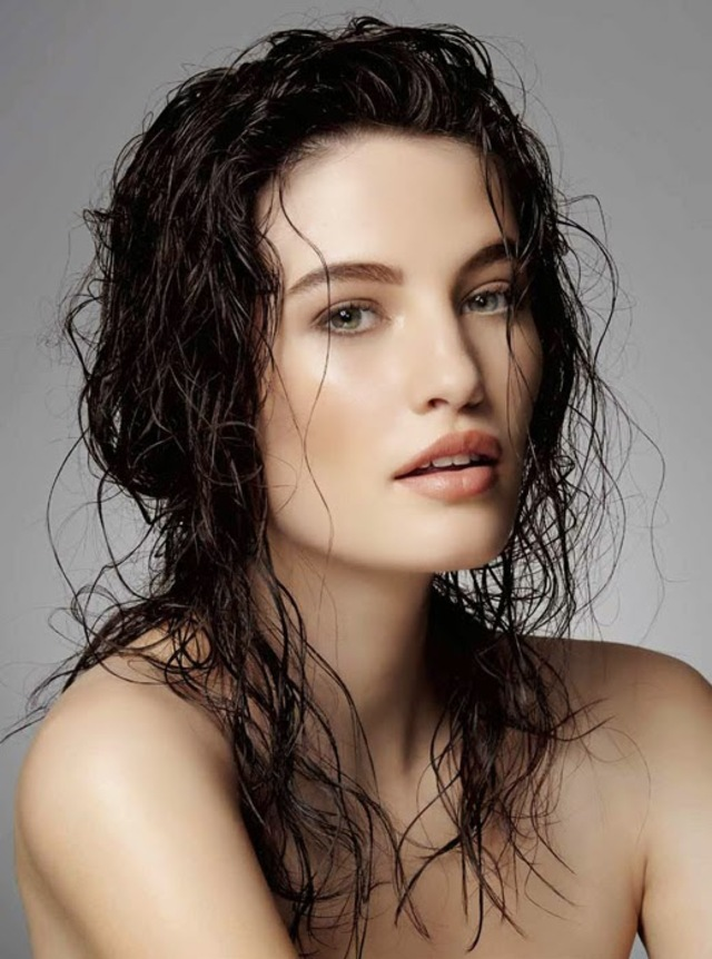 Photo of a girl at a photoshoot with wet hair
