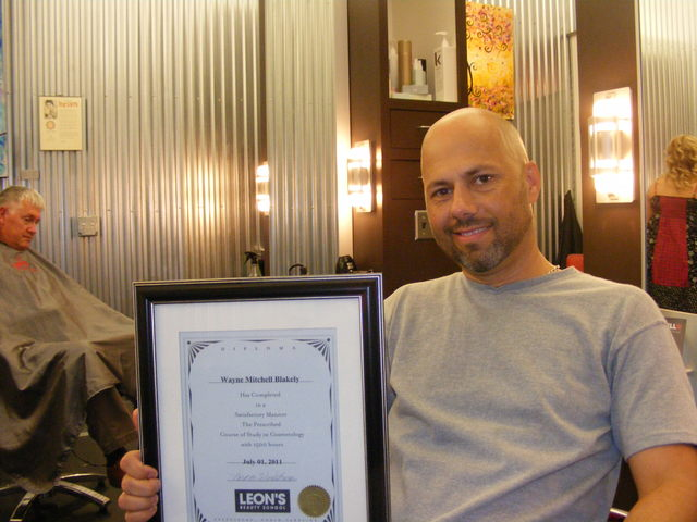 Me with my Diploma from Leon's Beauty School...