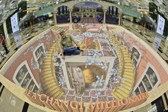 U.S. artist Wenner poses with his 3D art installation at Changi International Airport in Singapore