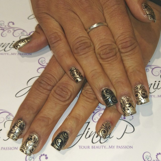 Gold & Black party nails