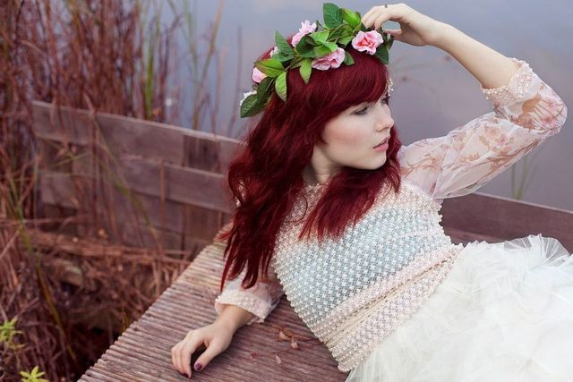 Red waves and flower crown