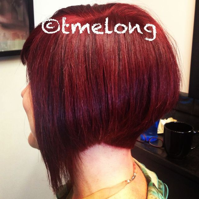 Sharon. Blunt bob with modern disconnection in a rich, dimensional ruby color.