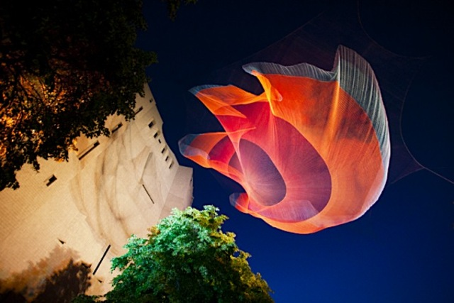 Janet Echelman glowing art hovering