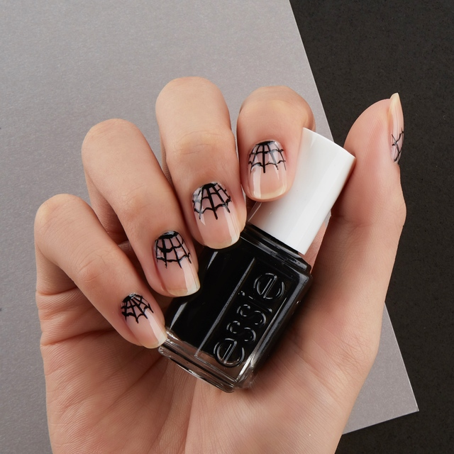 Re sized a3e3d03c153b8d655ad2 halloween cobweb nail art