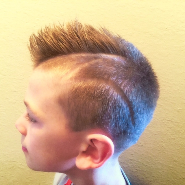 Boy's Haircut with hard part and design