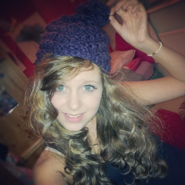 beanie and curly hair