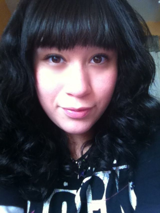black curly with bangs.