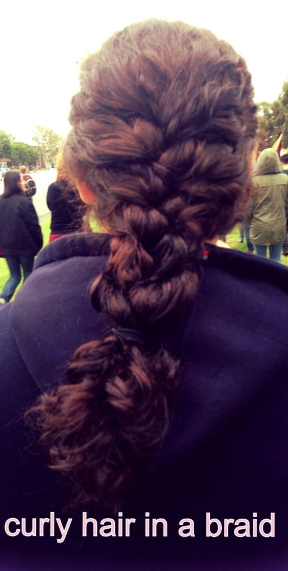curly hair in a loose braid