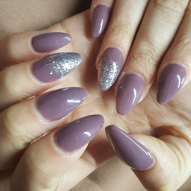 Long nude and glitter acrylic nails