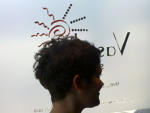 Asymmetrical  short curly cut at Vasuda Salon 2