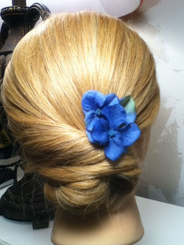 low twisted bun with a flower