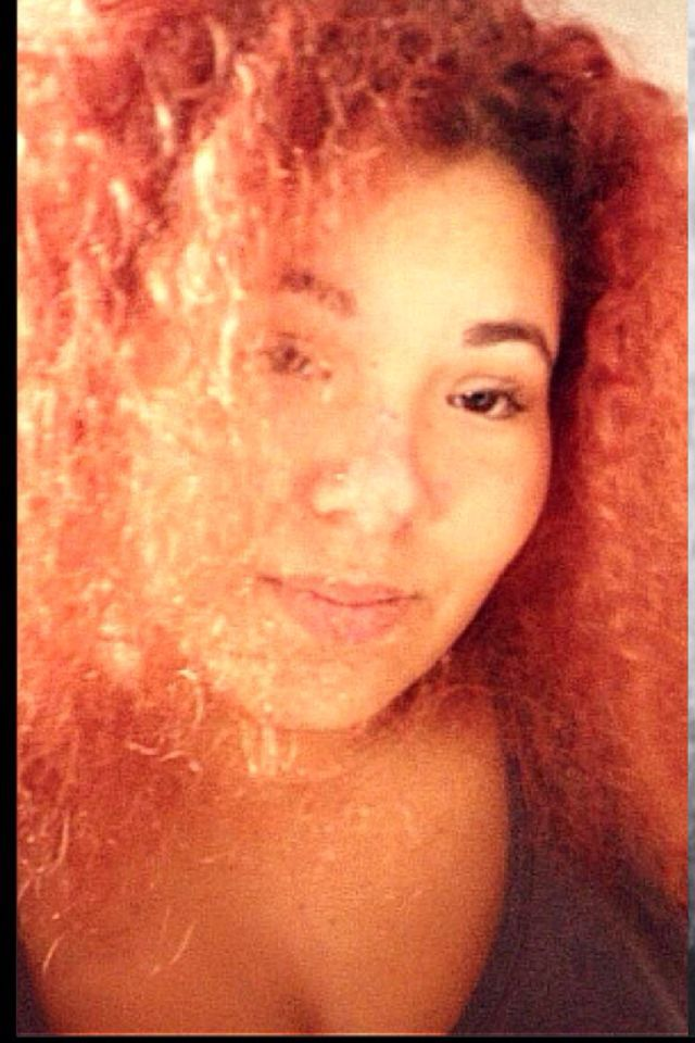 orange red curly big hair