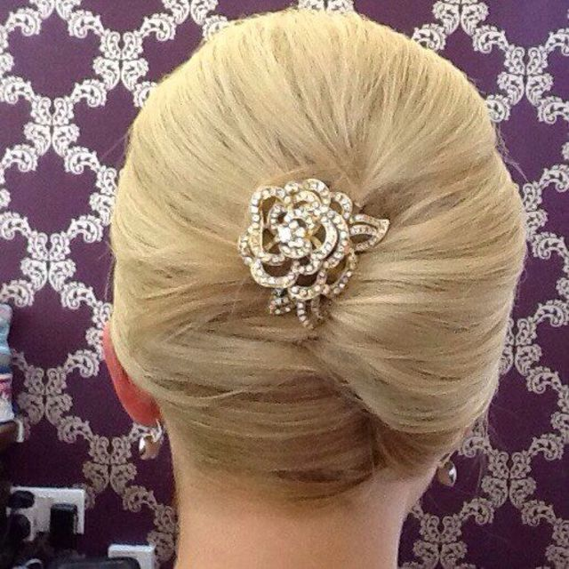 updo with rose hair pin