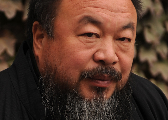 Chinese artist Ai Weiwei sits in the cou